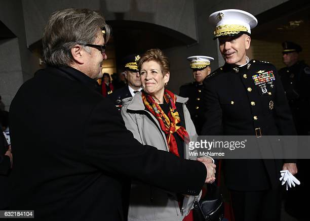 Senior Counselor Steve Bannon and Chairman of the Joint Chiefs of Staff Gen Joseph F Dunford greet each other before the presidential inauguration on...
