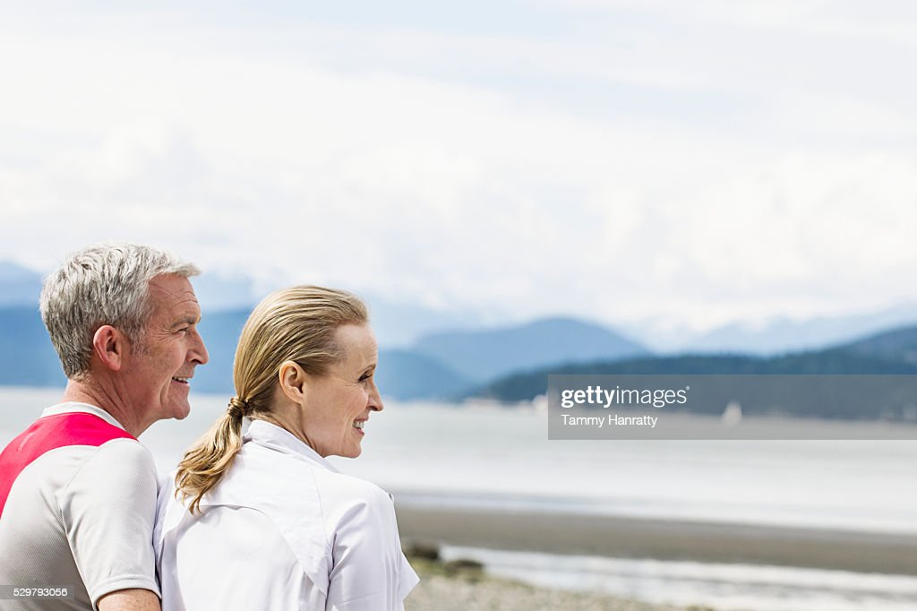 Senior couple admiring view of lake : Stock Photo