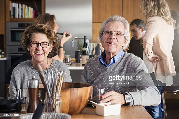 Senior couple after family dinner relaxing at table.
