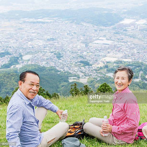 Senior Couple After Hiking Drinking Water