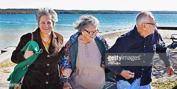 senior couple and mature daughter at the lake - fat granny stock pictures, royalty-free photos & images