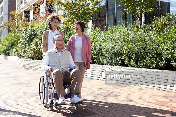 Senior couple and young woman talking a walk on street
