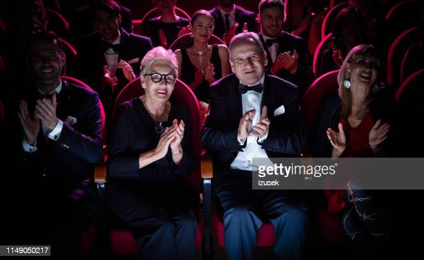 senior couple applauding in opera theater - formal stock pictures, royalty-free photos & images