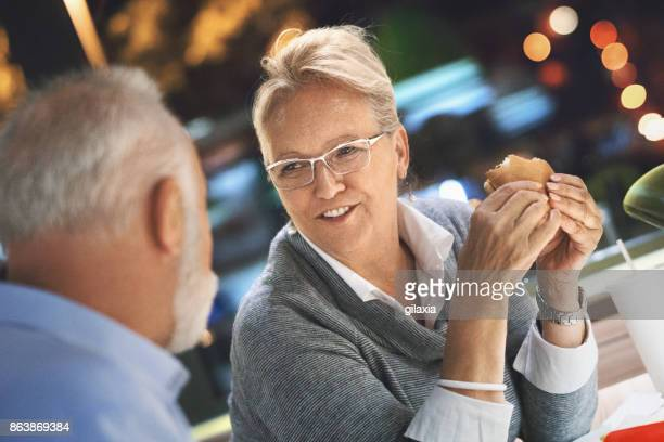 Senior couple at a diner.