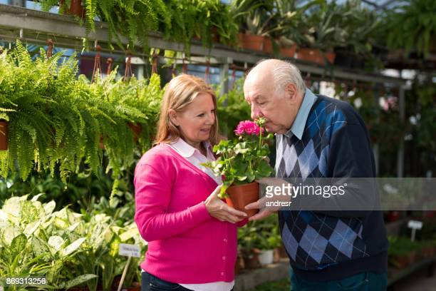Senior couple at a garden center looking at plants to buy