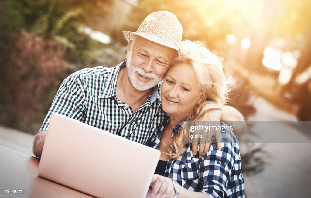 Senior couple at a sidewalk cafe. : Stock Photo