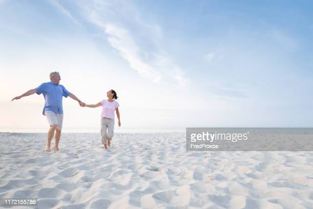 senior couple at beach - usedom stock pictures, royalty-free photos & images