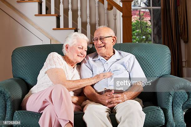 Senior couple at home laughing