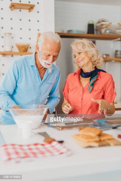 senior couple at home - women whipping men stock pictures, royalty-free photos & images