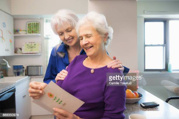 senior couple at home - open blouse - fotografias e filmes do acervo