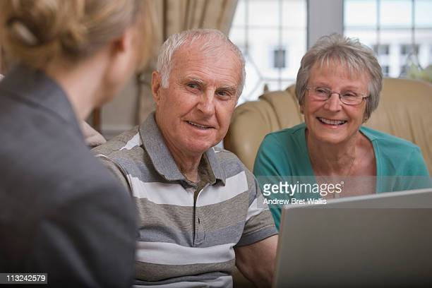 senior couple at home talking to an advisor - kingston upon hull stock pictures, royalty-free photos & images
