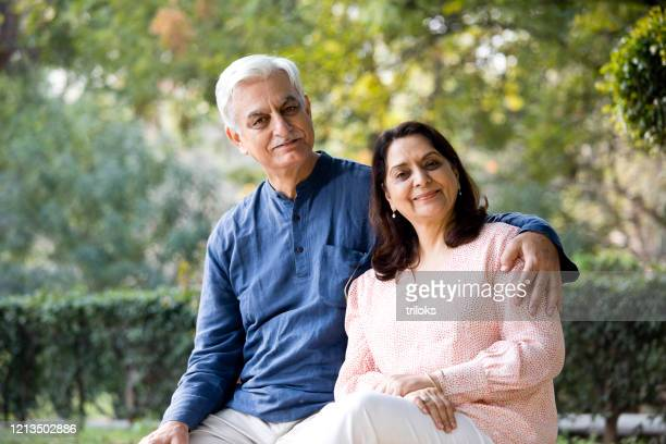 senior couple at park - indian ethnicity stock pictures, royalty-free photos & images