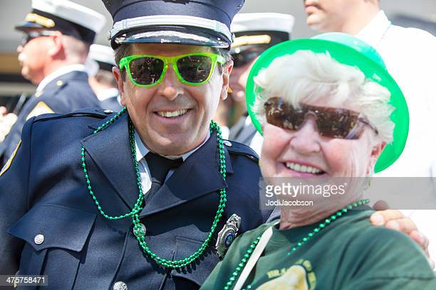 senior couple at st. patrick's day parade - delray beach stock photos and pictures