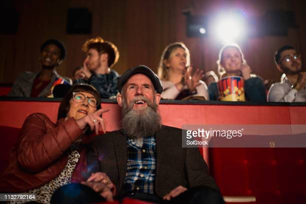 senior couple at the cinema - cinema stock pictures, royalty-free photos & images
