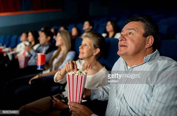 senior couple at the cinema - adult film stock photos and pictures