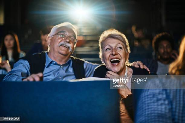 senior couple at the movies - film screening stock pictures, royalty-free photos & images