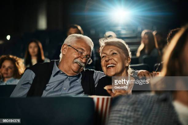 senior couple at the movies - adult film stock photos and pictures