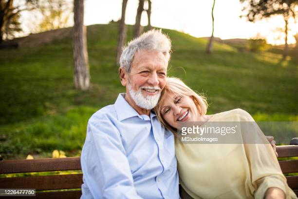 senior couple at the park. - positive emotion stock pictures, royalty-free photos & images