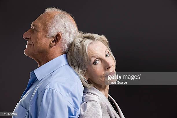 Senior couple back to back