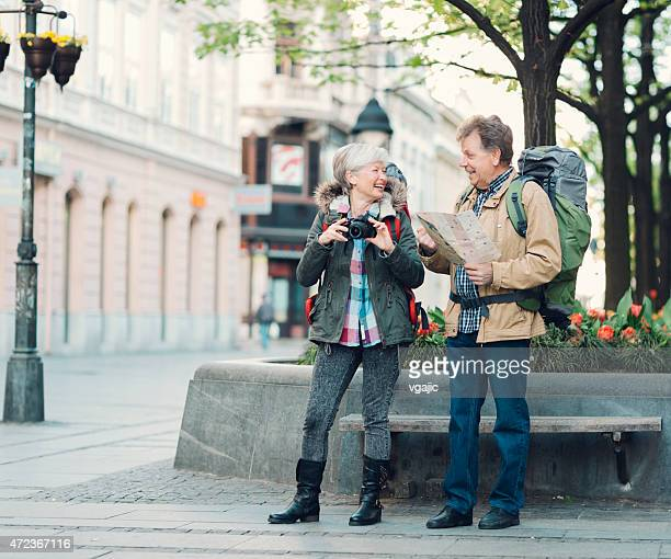 Senior Couple Backpackers in the city.