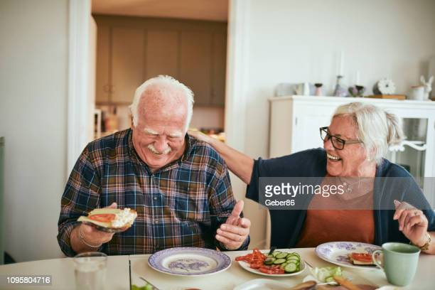 senior couple breakfast - senior adult stock pictures, royalty-free photos & images
