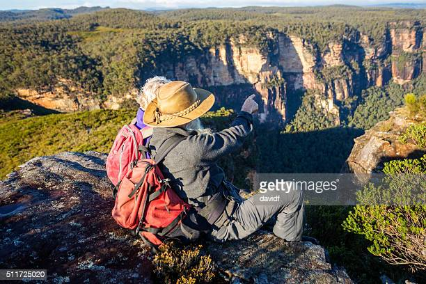 senior couple bushwalkers enjoying spectacular landscape views - katoomba stock pictures, royalty-free photos & images