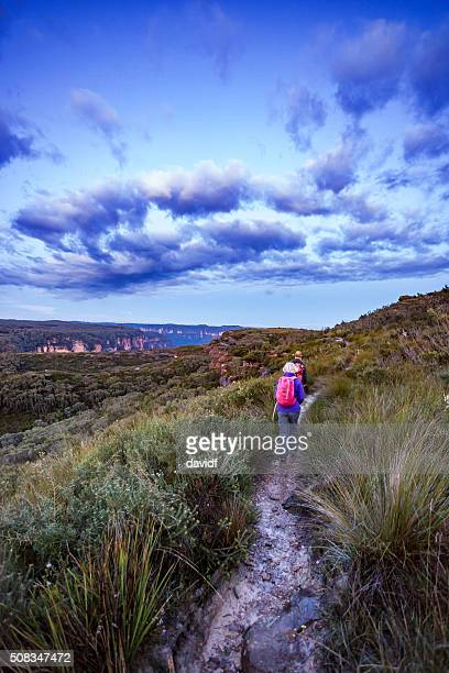 Senior Couple Bushwalking at Dawn in a Spectacular Landscape