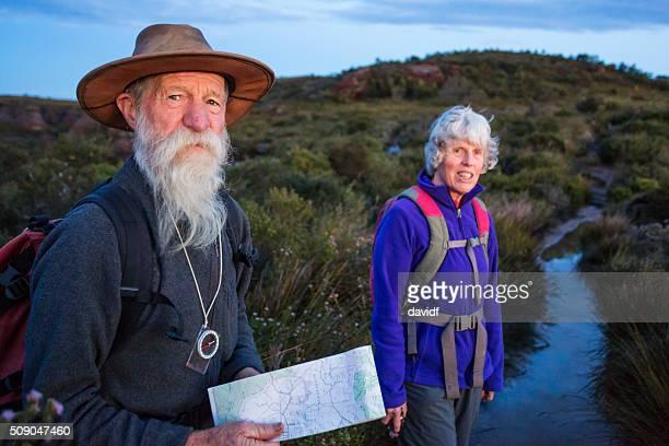 Senior Couple Bushwalking at Dawn in the Blue Mountains Australia