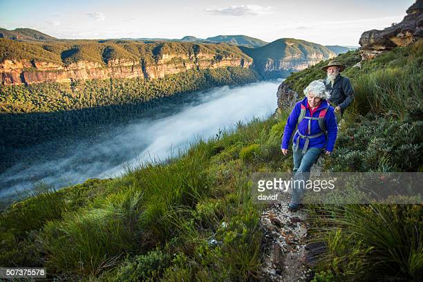senior couple bushwalking in spectacular blue mountains australian landscape - active senior stock photos and pictures