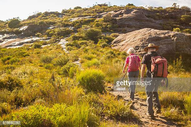 senior couple bushwalking in spectacular blue mountains australian landscape - katoomba stock pictures, royalty-free photos & images