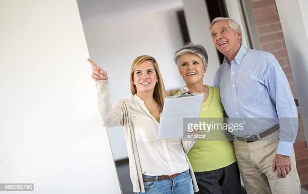 Senior couple buying a house