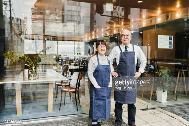 senior couple cafe owners working happily in cafe together - disruptagingcollection stock pictures, royalty-free photos & images