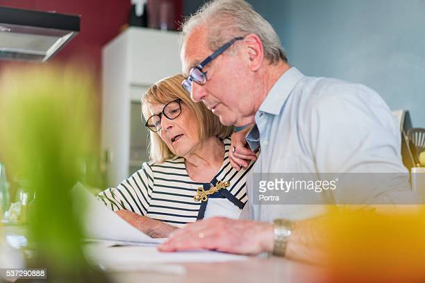 Senior couple calculating home finance