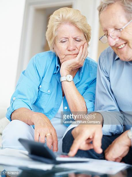 Senior couple calculating their accounts at home