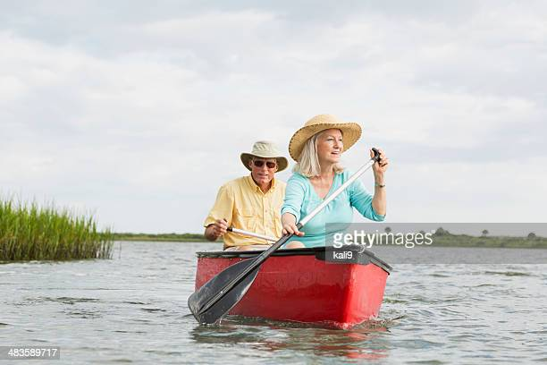 senior couple canoeing on intracoastal waterway, florida - 69 position stock photos and pictures