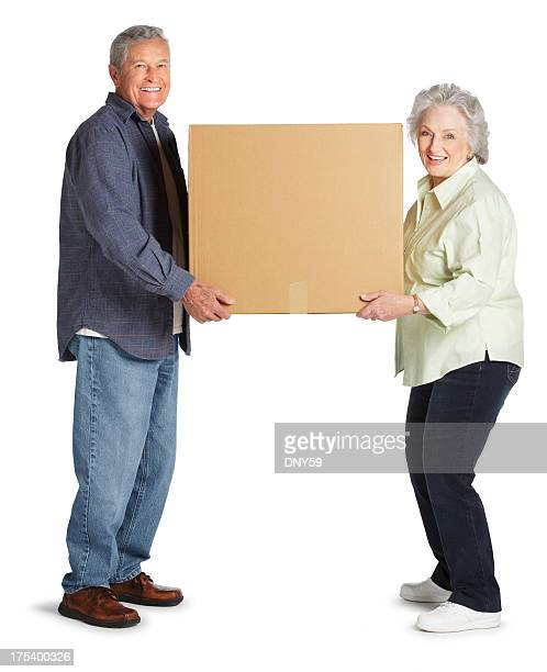 Senior Couple Carrying A Large Box