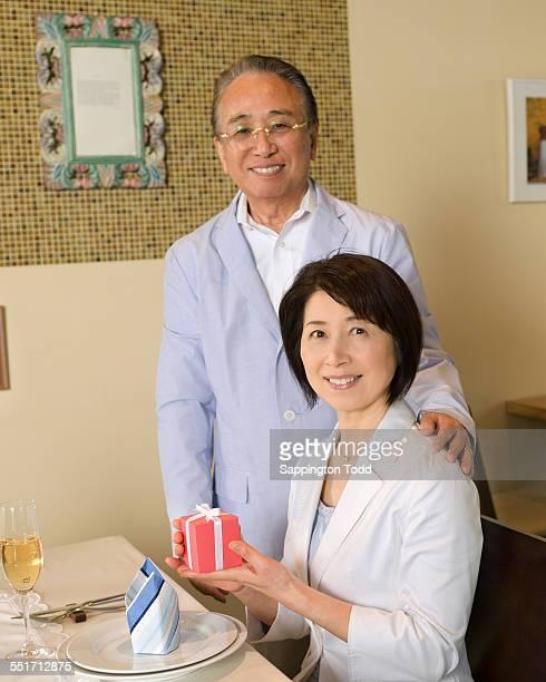 senior couple celebrating anniversary - 記念日 ストックフォトと画像