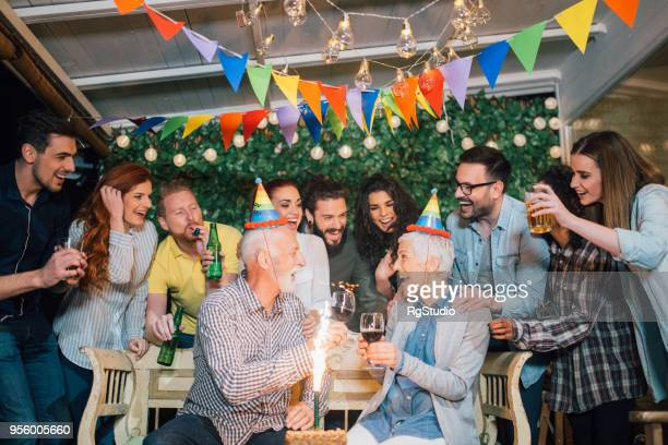 Senior couple celebrating birthday having celebratory toast