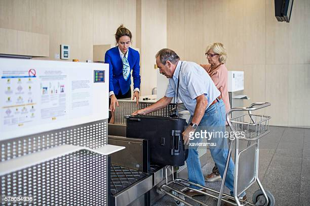 Senior couple checking in the airport