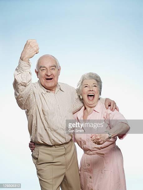 Senior couple cheering