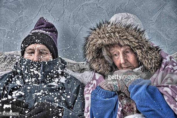 Senior couple, cold and miserable