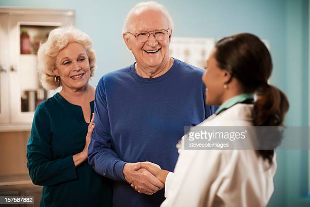 Senior Couple  Consulting and Female Doctor