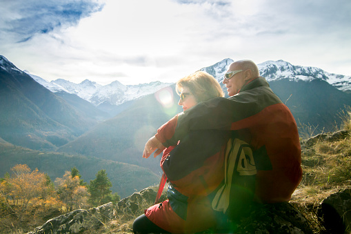 Senior couple contemplating and enjoying the view of the snowy summits - gettyimageskorea