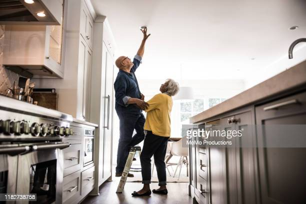 senior couple couple doing diy project at home - disruptaging stock pictures, royalty-free photos & images