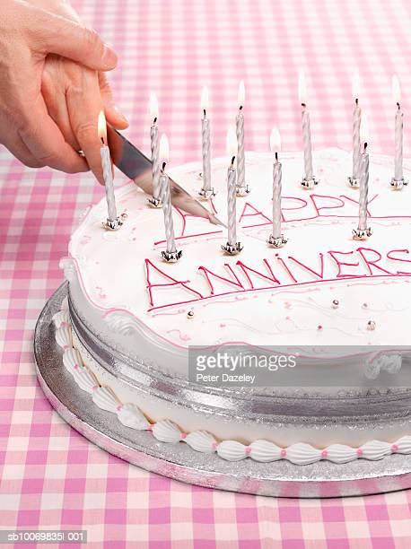 senior couple cutting cake, close-up - anniversary stock pictures, royalty-free photos & images