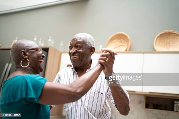 senior couple dancing at home - gratitude stock pictures, royalty-free photos & images