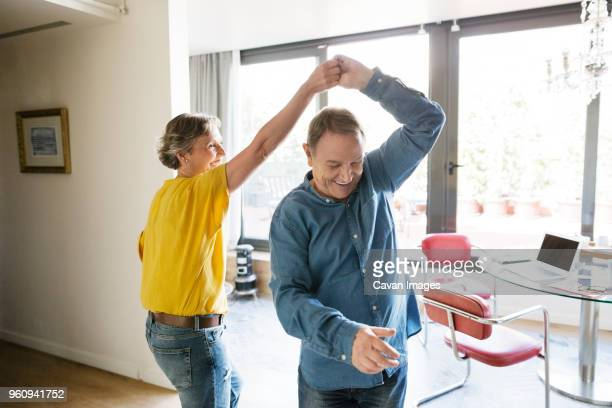 senior couple dancing at home - gesturing stock pictures, royalty-free photos & images