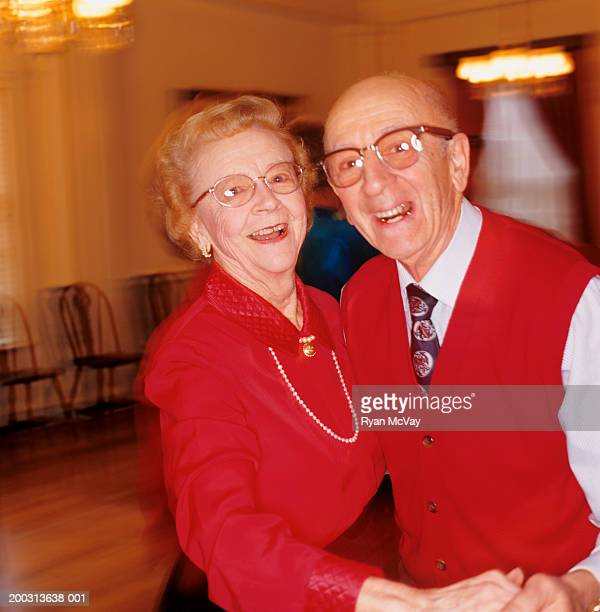 senior couple dancing in ballroom, portrait - wear red day stock photos and pictures