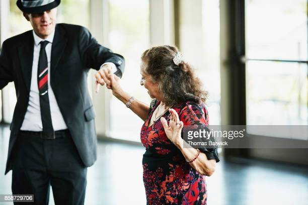 Senior couple dancing in community center