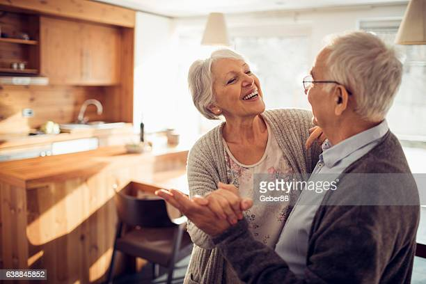 senior couple dancing - active senior woman stock photos and pictures